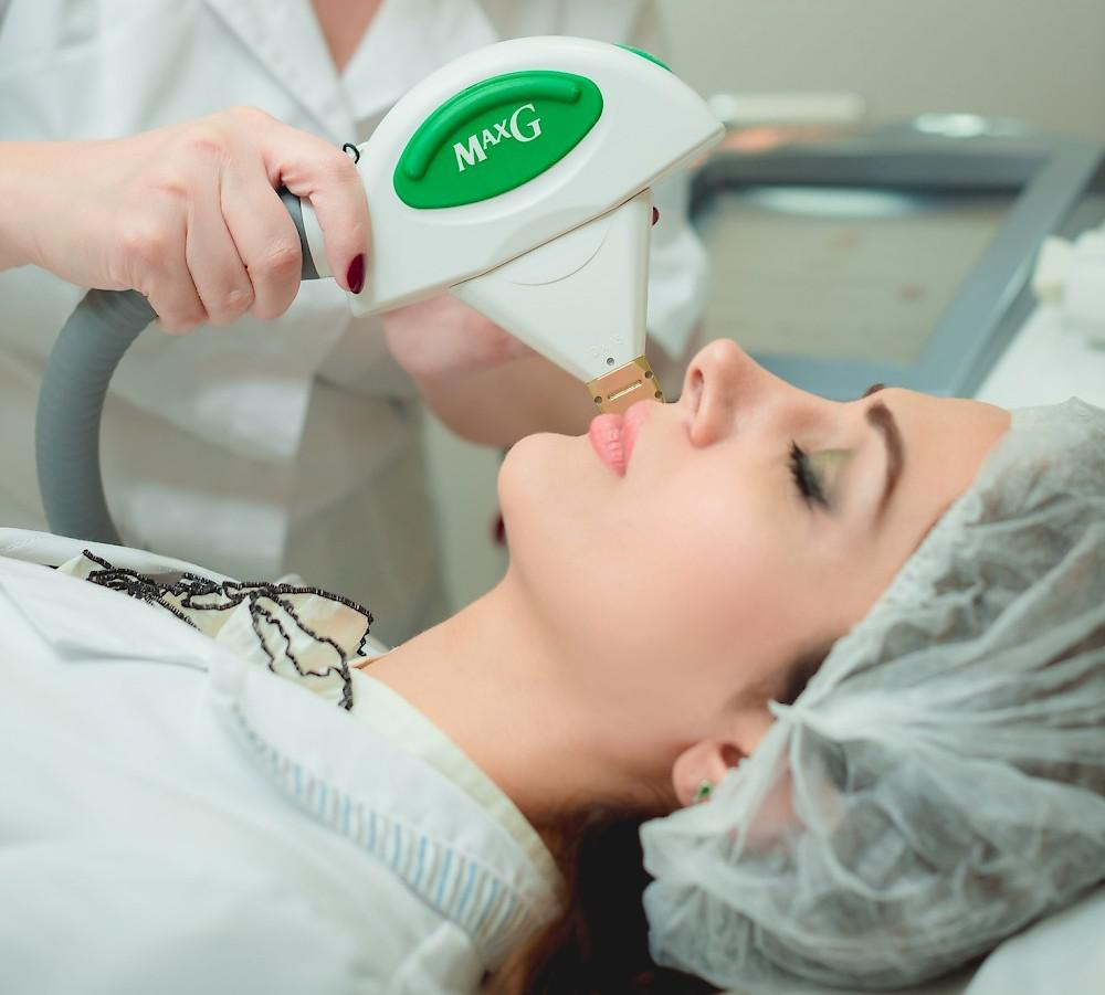 Photo of a female patient receiving IPL skin rejuvenation on her facial skin.